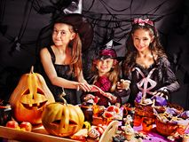 Children on Halloween party . Children on Halloween party  sitting at trick or treat table Royalty Free Stock Image