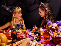 Children on Halloween party. Sitting at trick or treat table Royalty Free Stock Photo