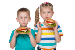 Children with hamburgers Stock Images