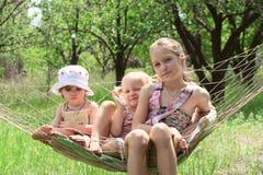 Children in a hammock Stock Image