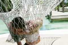 Children in hammock. Two children, boy and girl, having fun in a hammock Royalty Free Stock Photos