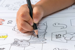 Children hand drawing by pencil Royalty Free Stock Photography