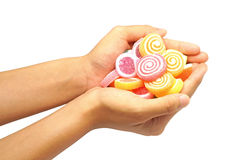 Children hand hold jelly sweet candy isolated on white Stock Photo