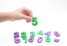 Children hand and numeral Stock Photo