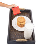 Children Hand Offers Milk, Cookies For Santa VI Royalty Free Stock Image