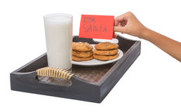Children Hand Offers Milk, Cookies For Santa VII Royalty Free Stock Images