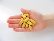 Children hand and pills. Many tablets in hand /children hand and pills Stock Image