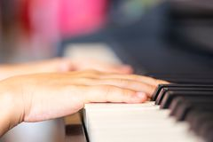 Children Hand playing Music keyboard Piano. Children Hand is playing Music keyboard Piano royalty free stock photography