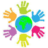 Children hand print around the Earth Royalty Free Stock Photo