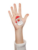 Children hand raising up with painted Santa Claus icon Christmas tree Stock Photos