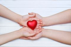 Children hand with red heart stock photography
