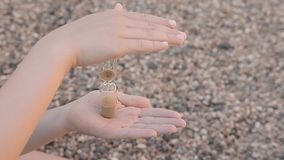 Children hand sand clock stone background hd footage. Day light stock video footage