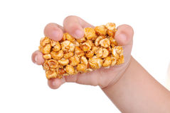 Children hand with sweet popcorn royalty free stock images
