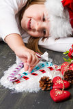 Children hand taking christmas decoration Royalty Free Stock Image