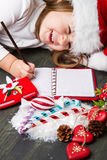 Children hand taking christmas decoration Stock Image