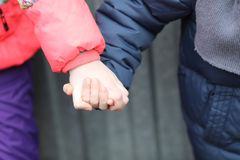 Children hand in hand together Stock Image