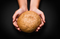 Children hands with bread Royalty Free Stock Images