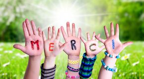Children Hands Building Word Merci Means Thank You, Grass Meadow