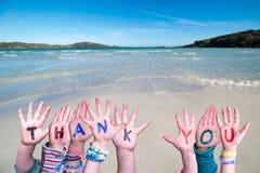 Children Hands Building Word Thank You, Ocean Background
