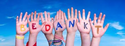 Children Hands Building Word Bedankt Means Thank You, Blue Sky