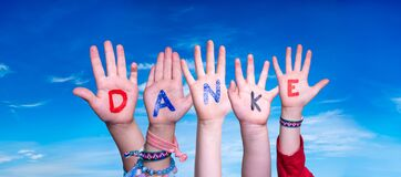Children Hands Building Word Danke Means Thank You, Blue Sky