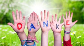 Children Hands Building Word Danke Means Thank You, Grass Meadow
