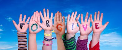 Free Children Hands Building Word Forgive, Blue Sky Royalty Free Stock Photos - 195562688