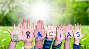 Children Hands Building Word Gracias Means Thank You, Grass Meadow