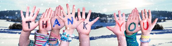Children Hands Building Word Thank You, Snowy Winter Background