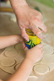 Children hands cook the circles of dough. Children and dad cook hands the circles of dough Stock Photos