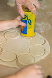 Children hands cook the circles of dough. Children and dad cook hands the circles of dough Stock Images