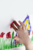 Children Hands doing Fingerpainting Stock Photo