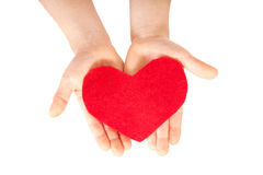 Children hands giving heart. Love concept. Royalty Free Stock Photo