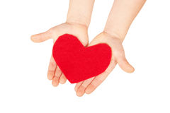 Children hands giving red heart. Stock Images