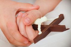 Children hands holding crucifix Royalty Free Stock Photography