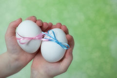 Children hands holding  Easter Eggs Royalty Free Stock Image