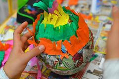 Children hands are making a pinata. royalty free stock image