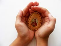 Children hands with orthodox icon. Close up Stock Photos