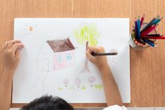 Children hands painting on paper Royalty Free Stock Photo