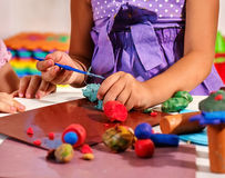 Children hands playing plasticine Stock Images