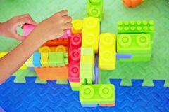 Children hands are playing toys royalty free stock image