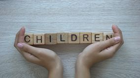 Children, hands pushing word on wooden cubes, family, education and future stock footage