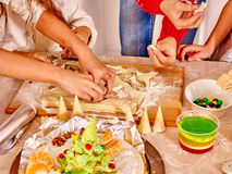 Children hands  rolling Xmas dough in the kitchen Royalty Free Stock Photography