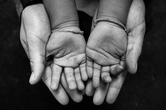 Children hands are scarce close up. Royalty Free Stock Photography