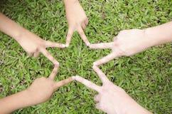 Children hands in star shape Stock Photo