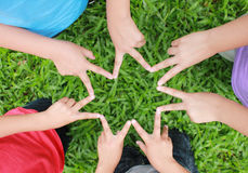 Children hands in star shape Royalty Free Stock Photo