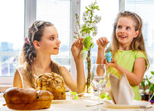 Children hang easter egg on cherry branch Stock Photography