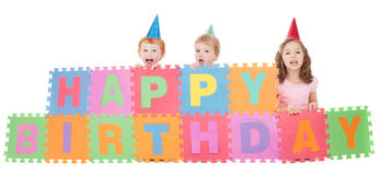 Children with happy birthday kids sign Stock Photos