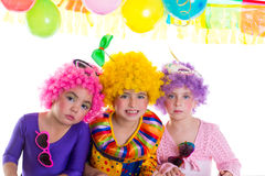 Children happy birthday party with clown wigs Stock Photos