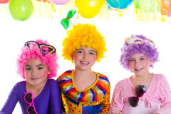 Children happy birthday party with clown wigs. Colorful holiday celebration Stock Images